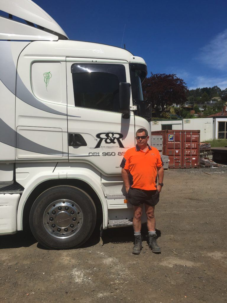 R & R Hiab Services team member Jonesy in front of one of their transport fleet